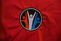 Embroidered fitness design in red cloth Royalty Free Stock Photo