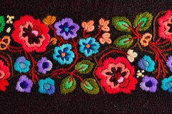 Embroidered flowers. Embroidered handmade colorful flower design stock photos