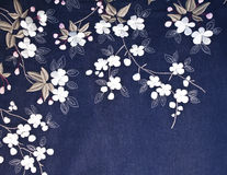 Embroidered flowers on denim royalty free stock images