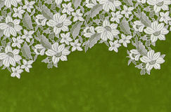Embroidered flowers laid over green paper Royalty Free Stock Photography
