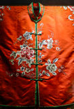 Embroidered flowers on red damask blouse,China. Shu embroidery,a kind of needlework centered in Chengdu of Sichuan province since Western Han Dynasty, is one of stock photo