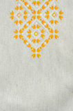 Embroidered Fragment On Flax By Yellow And White Cotton Threads. Macro Embroidery Texture Flat Stitch.