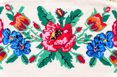 Embroidered good by cross-stitch pattern Stock Photography