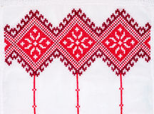 Embroidered good by cross-stitch pattern Stock Image