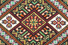 Embroidered good by cross-stitch pattern Stock Photos
