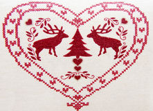 Embroidered heart and deer Stock Photos