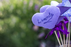 Embroidered heart with lavender. Embroidered heart on the background of lavender Royalty Free Stock Photography