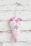 Embroidered heart  with a rose hanging on a nail for greeting ca Stock Image
