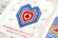 Embroidered heart and the text Stock Images