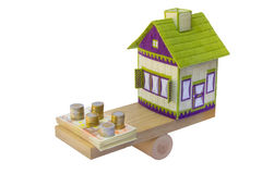 Embroidered House In Balance With Euro Money Stock Photo