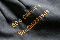 Embroidered initials or codes in a tailor workshop Royalty Free Stock Photo