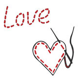 Embroidered inscription is love and heart with needle and thread Royalty Free Stock Images