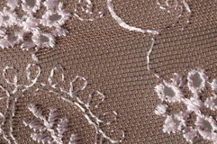 Embroidered lace flower. Close up of embroidered lace flower rose in  polyamide netting on gray background Stock Image