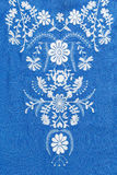 Embroidered pattern on blue Stock Images