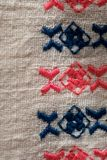 Embroidered pattern on cotton fabric . Fragment. Handmade Stock Image