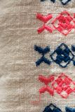 Embroidered pattern on cotton fabric . Fragment. Handmade Royalty Free Stock Image
