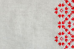 Embroidered pattern by red and white cotton threads for background or cover. Royalty Free Stock Photos