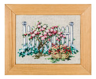 Embroidered picture in the frame Stock Photography