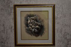Embroidered picture showing two raccoons. royalty free illustration