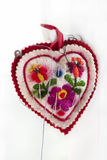 Embroidered pincushion in form heart with needles Stock Photo