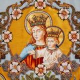 Embroidered religious icon Virgin Mary holding Jesus Stock Photos