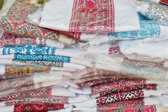 Embroidered shirts in plastic bags Royalty Free Stock Photo