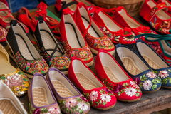 Embroidered shoes Yunnan Dali City stalls on the Dragon Stock Photography