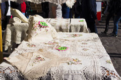 Embroidered tablecloths for sale on a market Royalty Free Stock Photography