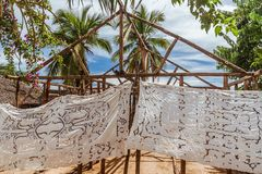 Embroidered tablecloths. Selling embroidered tablecloths in Nosy Komba & x28;Nosy Be& x29;, Madagascar Stock Image
