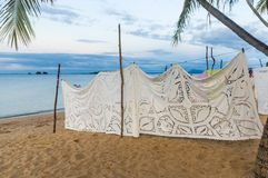 Embroidered tablecloths. Selling embroidered tablecloths in Nosy Komba (Nosy Be), Madagascar Royalty Free Stock Image