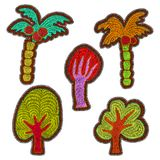 Embroidered trees - a set of stickers. Cartoon pictures drawn by Royalty Free Stock Photography