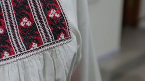 The embroidered Ukrainian clothes accessory. The Ukraine national embroidered accessories scarf and shirt stock video