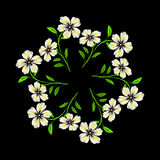 Embroidered white flowers on black background Stock Photos