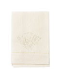 Embroidered white napkin Stock Images