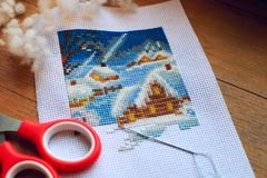 Embroidered winer and snowman. Winter cross stitch. Work in progress. Stock Images