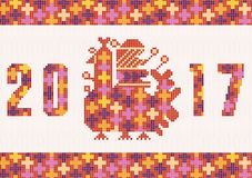 Embroidered wonderful handmade cross-stitch ethnic Ukraine pattern. Embroidering stylization 2017 New year of the rooster. High resolution Royalty Free Stock Photo