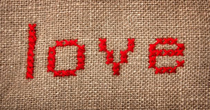 Embroidered word 'love'. Word 'love' embroidered on the sack stock photography