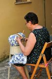 Embroiderer with craft wires in the city of Offida in Central It. Embroiderer with craft wires in the streets of the medieval city of Offida province of Ascoli royalty free stock photography