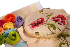 The embroideries. With peonies and different colored floss Stock Photography