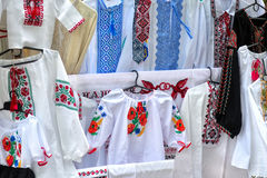 Embroideries. Traditional national Ukrainian handiwork embroidered and decorated shirts, dresses and towels popular nowadays in Ukraine as manifestation of Stock Photography