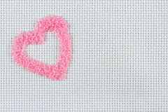 Embroidering with beads Stock Photo