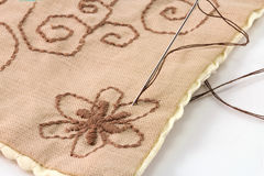 Embroidering brown flower Stock Photo
