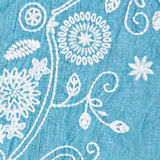 Embroidery. White embroidered pattern on a blue cotton garment Stock Image