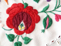 Embroidery. Close-up with red flower Stock Photography