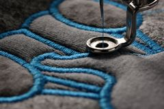embroidery and application with embroidery machine - macro of progress satin stitch stock photo