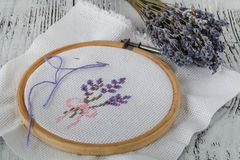 Embroidery bouquet of lavender and tools of needlework Stock Images