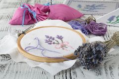Embroidery bouquet of lavender and tools of needlework Stock Photography