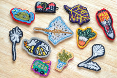 Embroidery brooches Royalty Free Stock Images