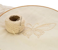 Embroidery candlewicking. Using candlewicking style of embroidery to create a butterfly with unbleached cotton in an embroidery hoop Stock Image