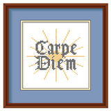 Embroidery, Carpe Diem, Cross Stitch, Wood Picture. Carpe Diem or Seize the day in Gothic script, sunrise background cross stitch needlework sewing design, blue Stock Image
